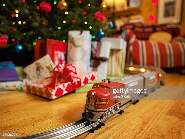 Toy train on track going around Christmas tree