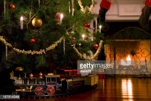 Toy Train Under The Christmas Tree Stock Photo
