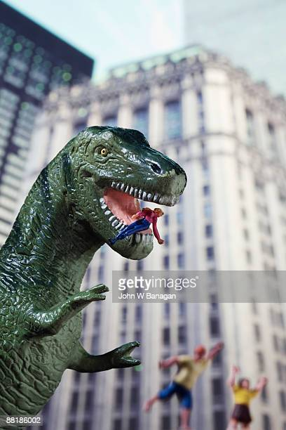Toy T-Rex attacking people
