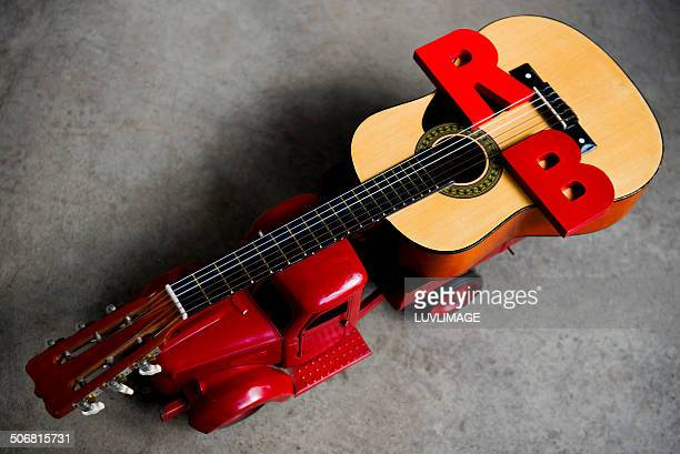 Toy truck with giant guitar and letters RB