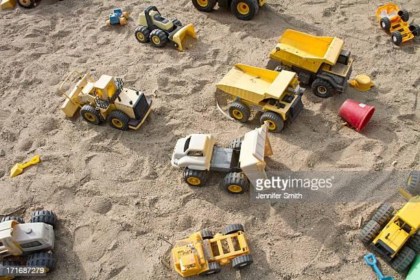 Toy trucks in a sandbox