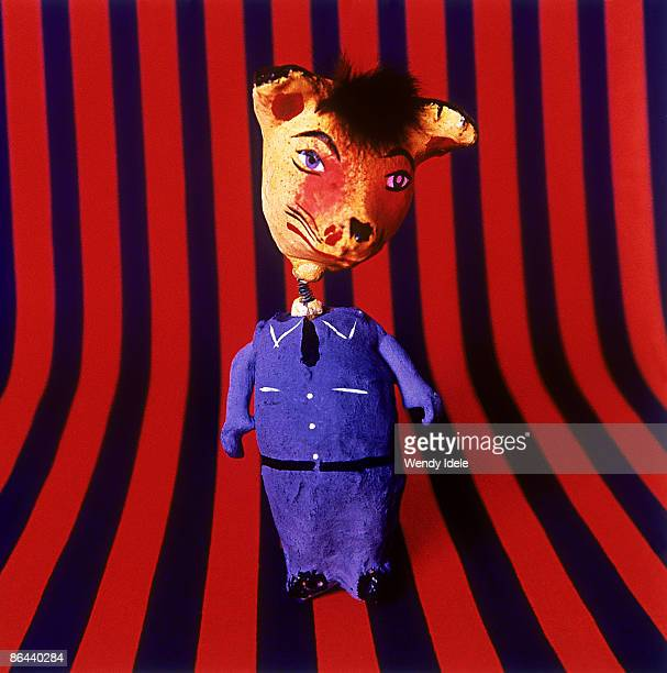 toy with a fox head in blue uniform - dolly fox stock pictures, royalty-free photos & images