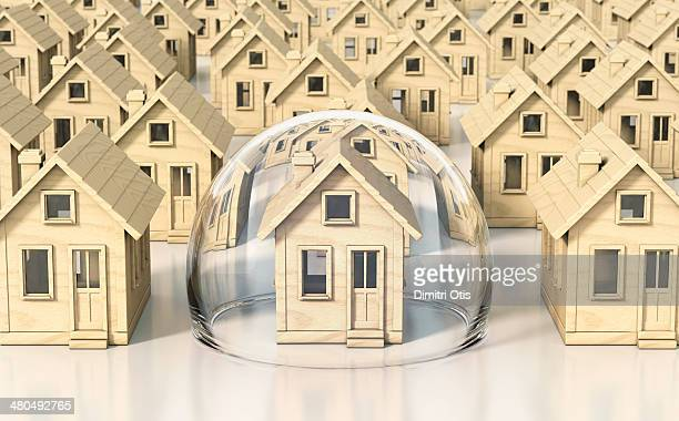 toy wooden miniature houses, one under glass dome - home insurance stock pictures, royalty-free photos & images