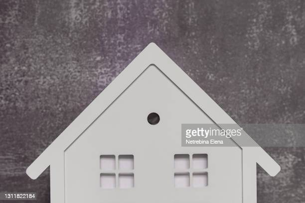 a toy wooden white house on a gray background. the concept of a real estate purchase offer. copy the space. mortgages, affordable housing. - mortgage stock pictures, royalty-free photos & images