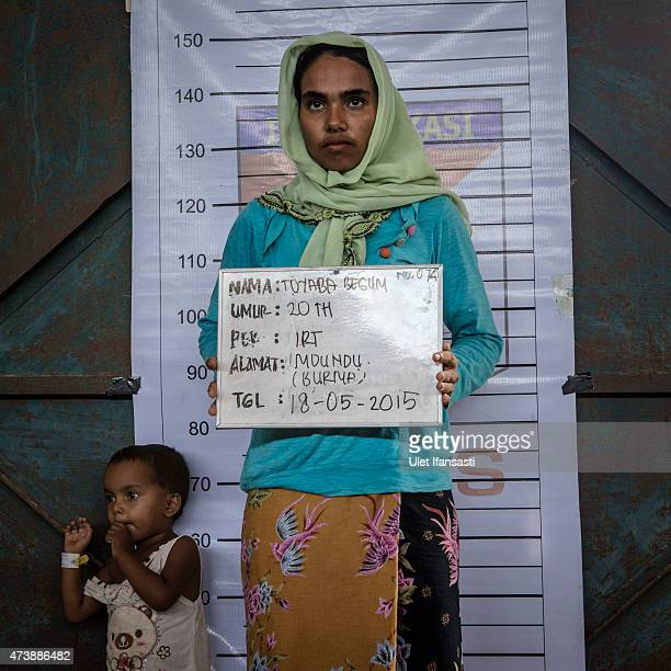Toyaba Begum a Rohingya migrant woman poses for identification purposes at a temporary shelter on May 18 2015 in Kuala Langsa Aceh province Indonesia...