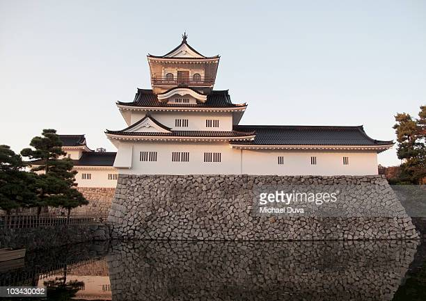 toyama castle with moat at sunset - 富山県 ストックフォトと画像