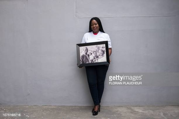 Toyin LoluOgunmade the founder of the agency Precious Conceptions which helps women with fertility problems poses with a picture of her family in the...