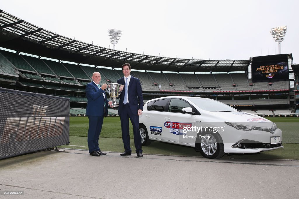 Toyita President Dave Buttner (L) and AFL CEO Gillon McLachlan pose with the AFL Premiership Cup during the 2017 AFL Finals Launch at Melbourne Cricket Ground on September 4, 2017 in Melbourne, Australia.