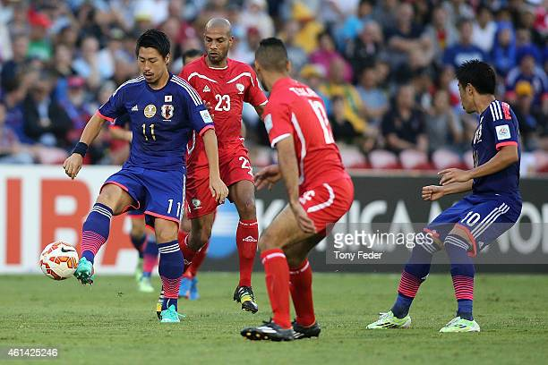 Toyoda Yohei of Japan controls the ball during the 2015 Asian Cup match between Japan and Palestine at Hunter Stadium on January 12 2015 in Newcastle...
