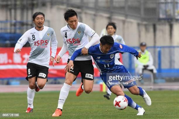 Toyofumi Sakano of Montedio Yamagata and Shinnosuke Hatanaka of Tokyo Verdy compete for the ball during the JLeague J2 match between Montedio...