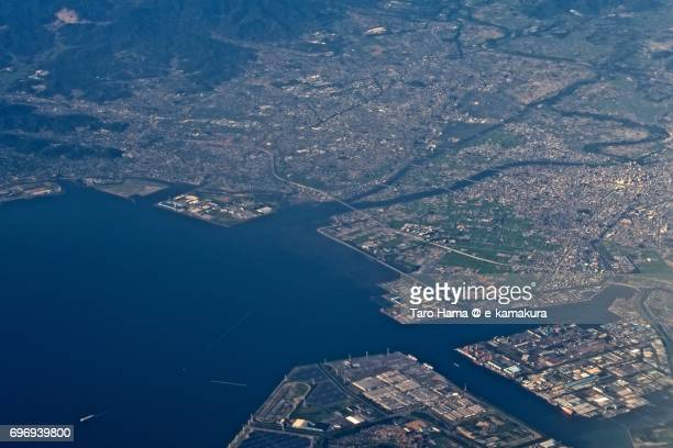 Toyohashi city and Atsumi Bay sunset time aerial view from airplane
