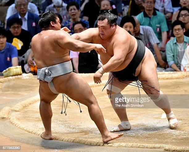 Toyohibiki pushes Mongolian wrestler Takanoiwa to win during day eight of the Grand Sumo Nagoya Tournament at the Aichi Prefecture Gymnasium on July...