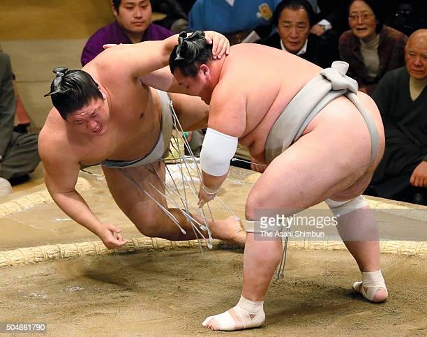 Toyohibiki throws Mongolian wrestler Takanoiwa to win during day three of the Grand Sumo New Year Tournament at Ryogoku Kokugikan on January 12 2016...