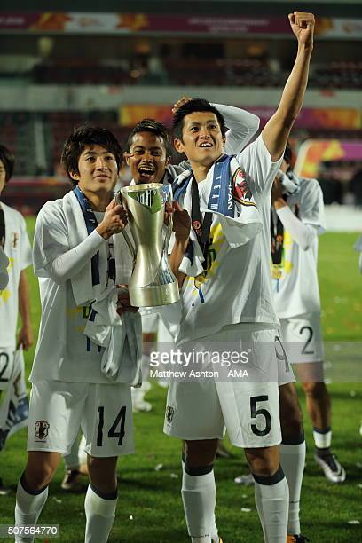 Toyokawa Yuta and Masashi Kamekawa of Japan celebrate with the trophy after the victory in the AFC U23 Championship final match between South Korea...