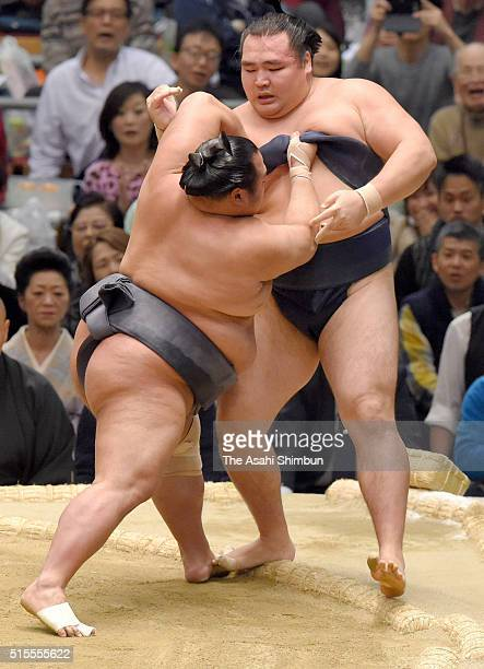 Toyonoshima pushes Mongolian yokozuna Kakuryu to win during day one of the Grand Sumo Spring Tournament at the Edion Arena Osaka on March 13 2016 in...