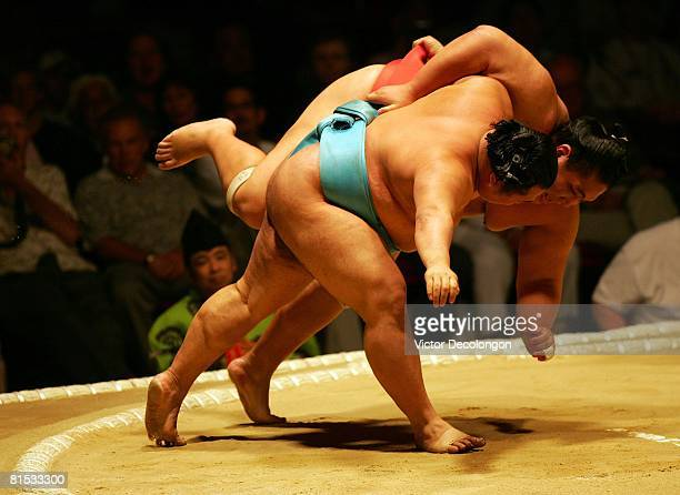 Toyonoshima uses the underarm throw or 'shitatenage' to defeat Miyabiyama in the third round during the 2008 Grand Sumo Tournament at the Los Angeles...
