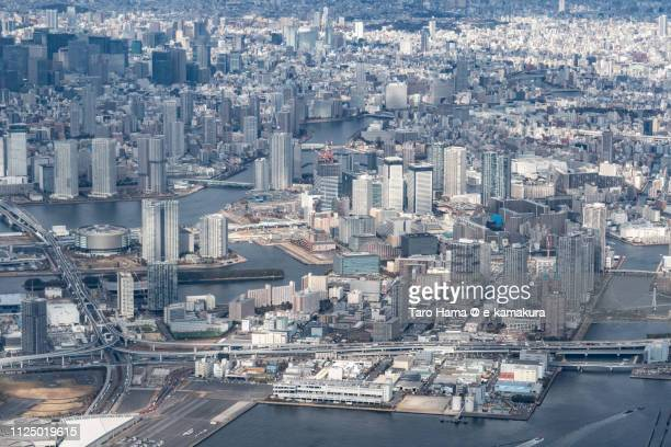 Toyosu and Harumi Pier in Tokyo in Japan daytime aerial view from airplane