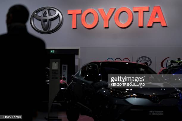 Toyota automobile logo is pictured during the Brussels Motor Show on January 9, 2020 in Brussels .