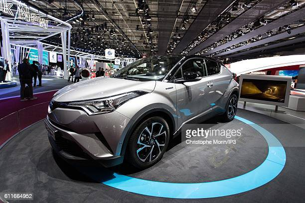 Toyota brand presents their latest Toyota CHR hybrid car during the press preview of the Paris Motor Show at Paris Expo Porte de Versailles on...