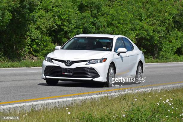 toyota camry in motion - toyota motor co stock pictures, royalty-free photos & images