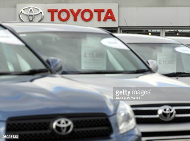 Toyota cars are lined up outside a Toyota dealership in Stockport north west England on March 26 2010 Crisishit Toyota said Friday it will suspend...