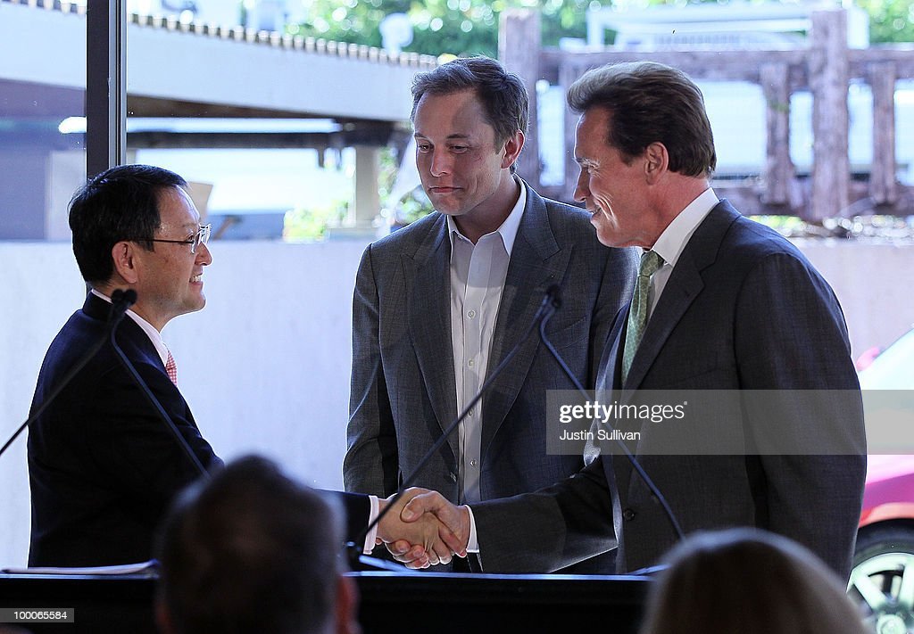 Toyota CEO Akio Toyoda, Tesla Motors CEO Elon Musk and California governor Arnold Schwarzenegger shake hands during a news conference at Tesla Motors headquarters May 20, 2010 in Palo Alto, California. Electric car maker Tesla Motors annoucned a partnership with Japanese automaker Toyota to make electric cars in the United States. The cars will be manufactured at the recently shuttered NUMMI plant in Fremont, California where Toyota had pulled out after a joint partnership with General Motors had ended.