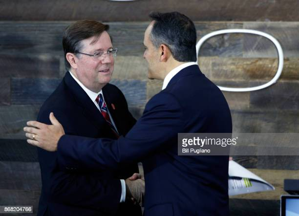 Toyota CEO Jim Lentz shakes hands with and Kentucky Governor Matt Bevin at the unveiling of a new $80 million Toyota engineering headquarters October...