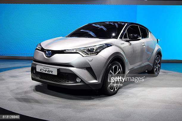 toyota c-hr hybrid on the motor show - toyota motor co stock pictures, royalty-free photos & images