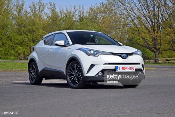 toyota c-hr hybrid on the road - hybrid vehicle stock pictures, royalty-free photos & images