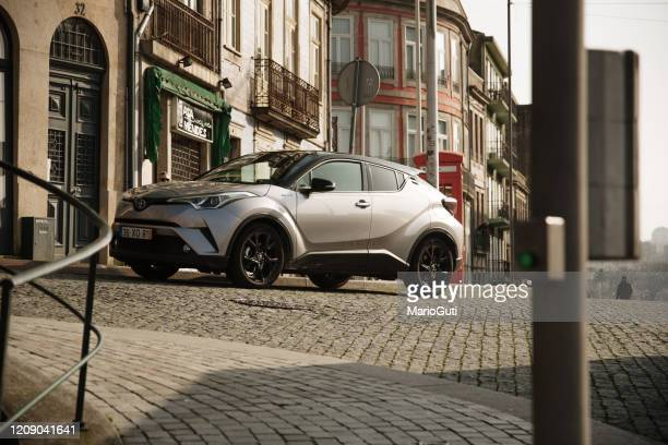 toyota c-hr in a city street - toyota motor co stock pictures, royalty-free photos & images