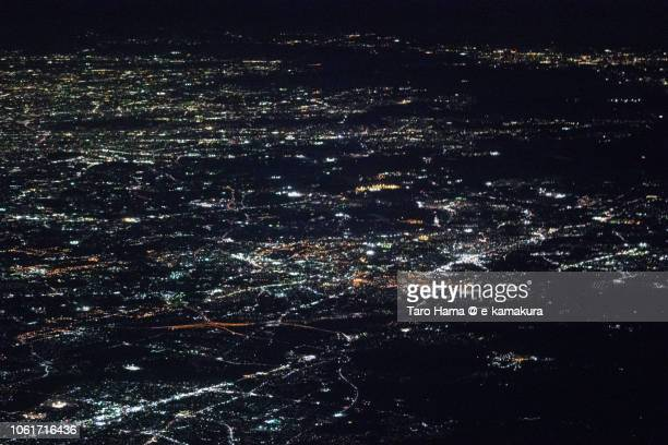 toyota city in aichi prefecture in japan night time aerial view from airplane - toyota city stock pictures, royalty-free photos & images