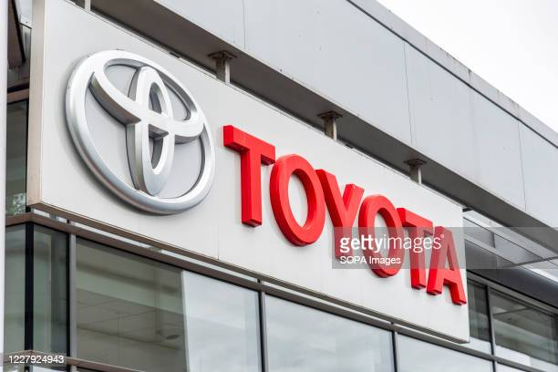 Toyota company logo seen on one of their car dealerships showrooms in London.