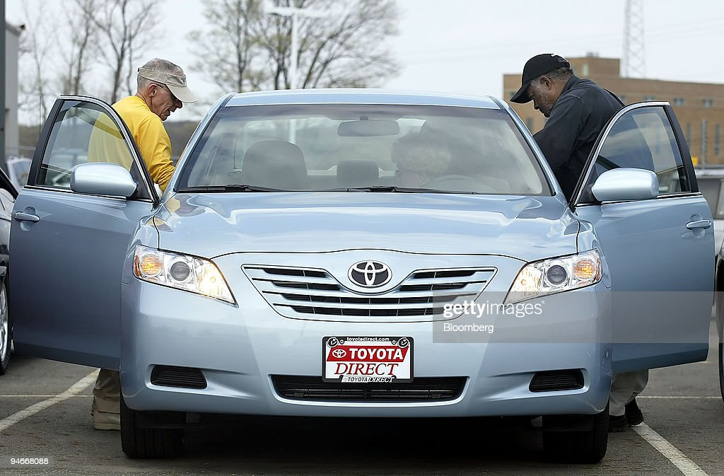 Toyota Direct Sales Person Randolph Manzie, Right, Helps William, Left, And  Joann