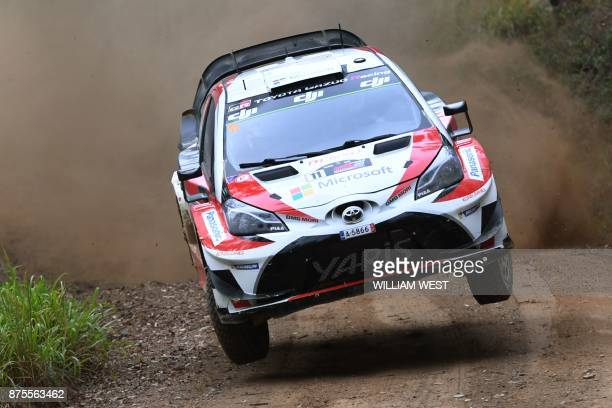 Toyota driver Esapekka Lappi of Finland leaps over a jump on the second day of World Rally Championship event Rally Australia near Coffs Harbour on...