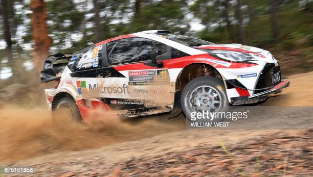 Toyota driver Esapekka Lappi of Finland powers through a corner on the first day of World Rally Championship event Rally Australia near Coffs Harbour...