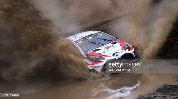 Toyota driver Esapekka Lappi of Finland powers through a water hazard on the first day of World Rally Championship event Rally Australia near Coffs...