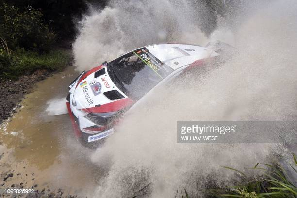 Toyota driver Esapekka Lappi of Finland speeds through a creek on the first day of the World Rally Championship Rally Australia near Coffs Harbour on...