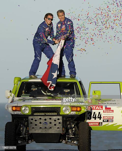 Toyota driver Jorge Latrach and codriver Juan Latrach from Chile launch confetti on the podium during the symbolic start of the 2012 Dakar Rally in...
