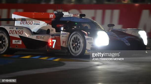 Toyota driver Kamui Kobayashi powers through a turn in a TS050 Hybrid LMP1 during the qualifying practise session of the 86th edition of the 24 Hours...