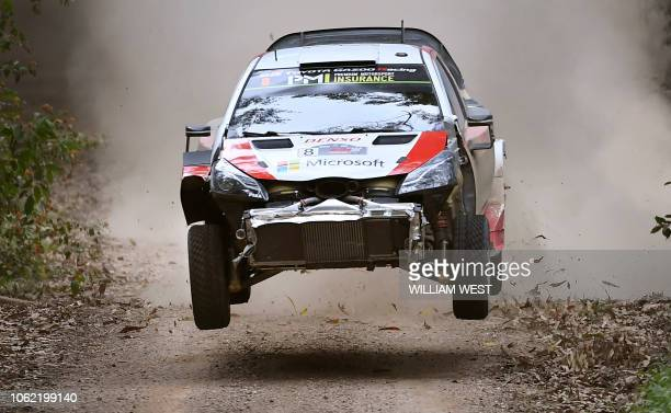 Toyota driver Ott Tanak of Estonia speeds over a brow in his damaged car on the first day of the World Rally Championship Rally Australia near Coffs...
