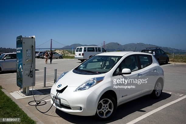 toyota electric vehicle charging - hybrid car stock photos and pictures