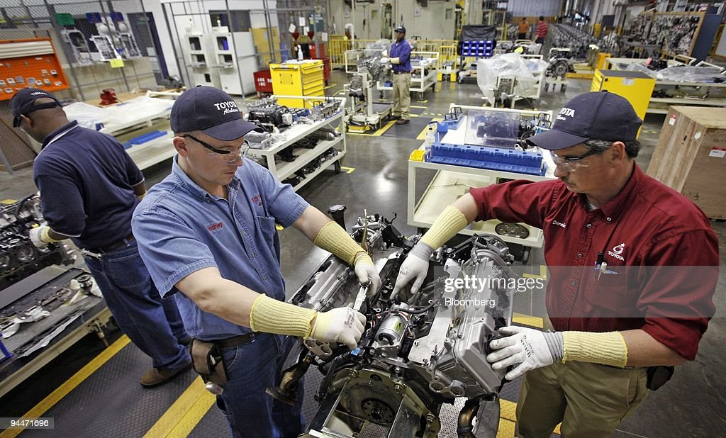 Toyota Employees Rodney Newton, Left, And Dennis Billion Disassemble A Motor  In The Quality