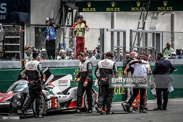 Toyota Gazoo Racing #5 Toyota TS050 Hybrid Driver Kazuki Nakajima gets out of the car on the main straight after his dramatic finish of the 84th...