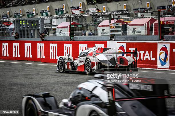 Toyota Gazoo Racing #5 Toyota TS050 Hybrid with Drivers Anthony Davidson Sebastien Buemi and Kazuki Nakajima passed by LMP1 Porsche Team #2 Porsche...