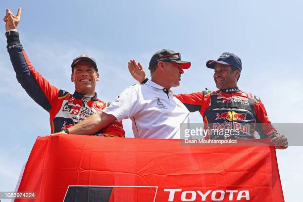 Toyota Gazoo Racing Sa no 301 TOYOTA HILUX car driven by Nasser AlAttiyah of Qatar and Matthieu Baumel of France celebrate as they cross the finish...
