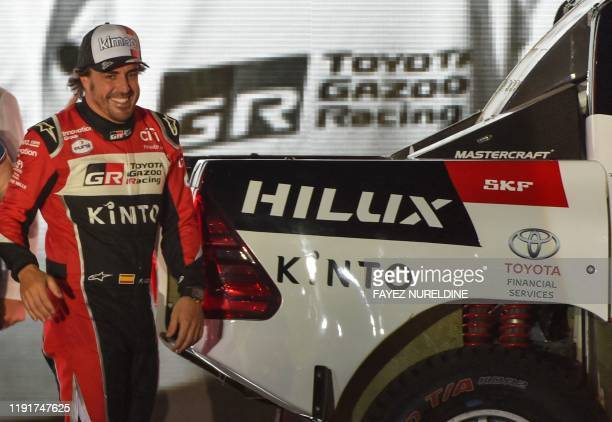 Toyota Gazoo Racing's Spanish driver Fernando Alonso smiles during the podium ceremony in Jeddah, on January 4 ahead of the 2020 Dakar Rally, which...