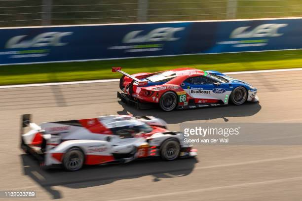 Toyota GAZOO TS050 Hybrid LMP1 race car driven by A. DAVIDSON / S. BUEMI / K. NAKAJIMA overtaking the Ford Chip Ganassi Racing Ford GT race car of...