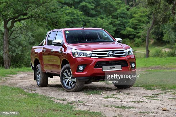 toyota hilux on the road - toyota motor co stock pictures, royalty-free photos & images
