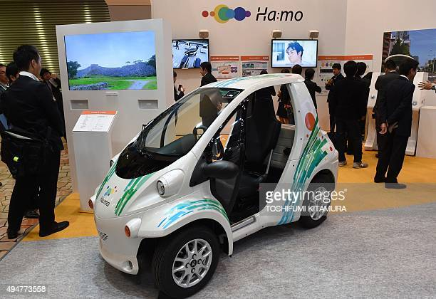 Toyota introduces the next generation transport system Hamo using Toyota's electronics small city commuter COMS at the Tokyo Motor Show in Tokyo on...
