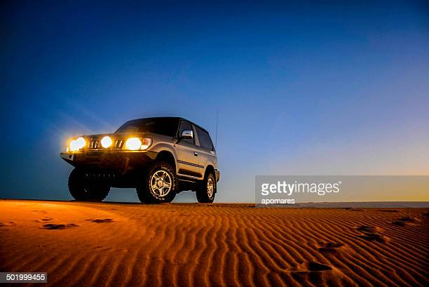 toyota land cruiser prado on desert sand dunes - toyota motor co stock pictures, royalty-free photos & images